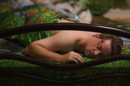 swooned: Corpse of killed man in a bedroom Stock Photo
