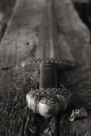 viking: War symbol. Medieval viking sword against a wooden wall Stock Photo