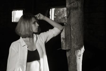 barn girls: Beauty woman posing at the wooden barn Stock Photo
