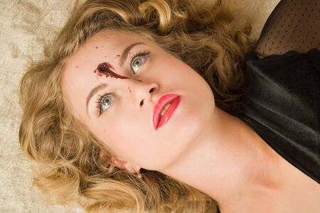 lifeless: Crime scene simulation. Lifeless woman lying on a bed