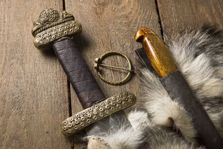 karoling: Still life with the viking sword and knife on a fur
