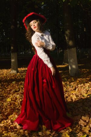 madam: Pretty woman dressed in a retro-style on the autumn alley Stock Photo