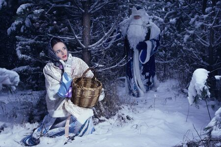 'ded moroz': Russian Christmas characters: Ded Moroz (Father Frost) and girl in the winter forest