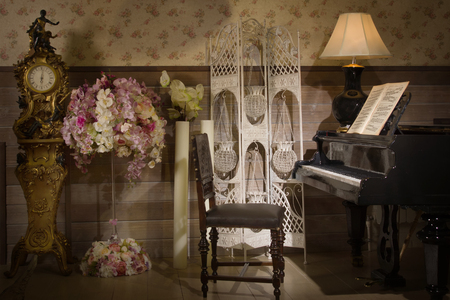 old piano: The Luxurious vintage interior with old piano Stock Photo