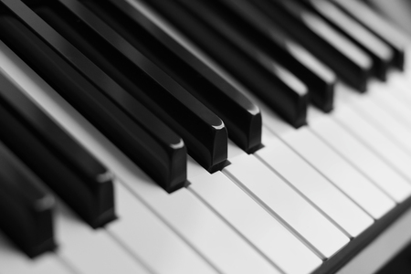 Piano keys closeup monochrome. Selective focus