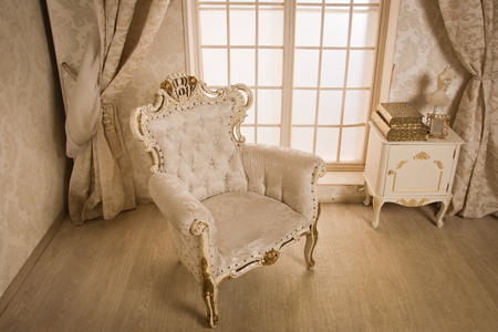 baroque room: Antique chair at interior of a vintage style room Stock Photo