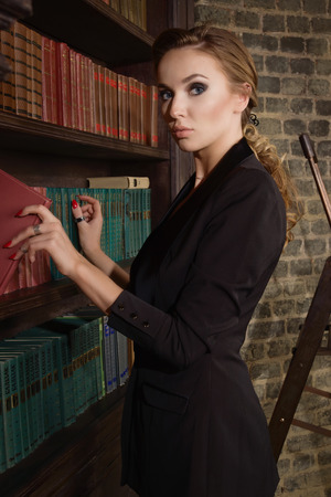 bibliophile: Confident business woman in the classical library room