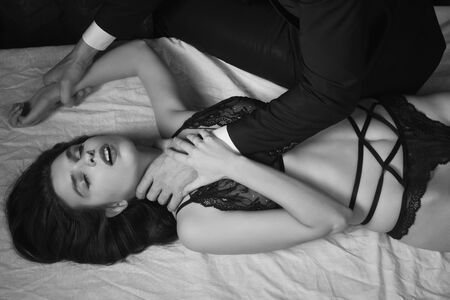 adult rape: Sexual woman being strangled in a loft interior Stock Photo
