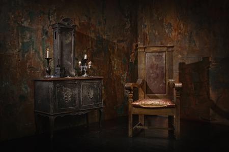 Mystical dark interior against a grungy brick wall Foto de archivo