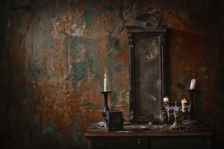 Mystical dark interior against a grungy brick wall Stock Photo