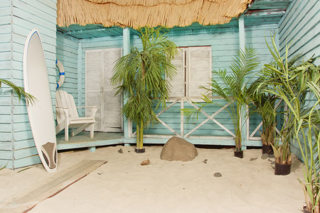 bungalows: Summertime. Sandy beach. Palm bungalows on white sand beach.