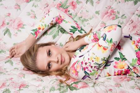 sensuality: Sensuality young woman lying on sofa. Boudoir type shooting.