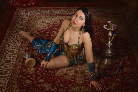 BELLY DANCING: Beautiful traditional female dancer. Oriental dancer woman. Belly dancing.