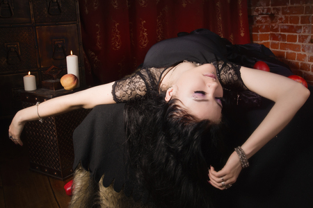 poisoned: Gothic Snow White. Woman with poisoned apple lies in a tomb