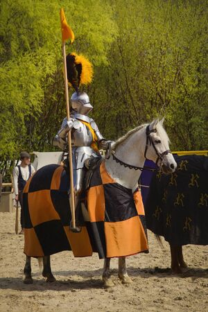 showmanship: The horse knight in an armour and in a helmet. St.George knightly tournament. Moscow on May 1, 2016