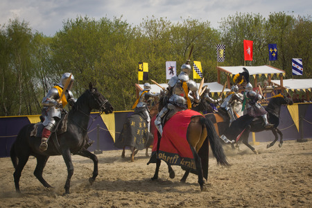 knight on horse: The horse knights in an armour and in a helmet with a sword in a hand. St.George knightly tournament. Moscow on May 1, 2016