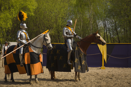 chivalry: The horse knights in an armour and in a helmet with a sword in a hand. St.George knightly tournament. Moscow on May 1, 2016