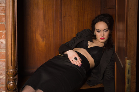 swooned: Crime scene. Dead business woman dressed black suit in the closet