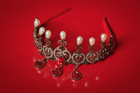 diadem: Diadem with large stones. bijouterie on a red background. Stock Photo