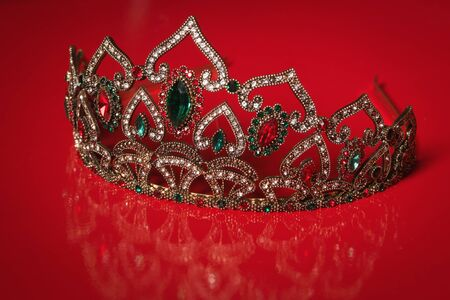 platinum hair: Diadem with large stones. bijouterie on a red background. Stock Photo
