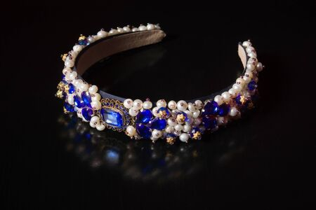 platinum hair: Diadem with large stones. bijouterie on a black background. Stock Photo