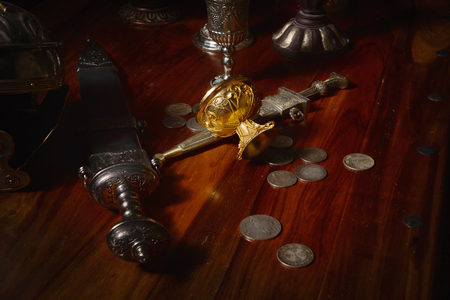 gladius: Ancient Rome concept. Gladius, antique hand weapon, helmet on a table