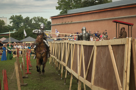 cavalryman: SAINT-PETERSBURG, RUSSIA - JULY 17, 2016: Battle on a Neva knightly tournament. Medieval jousting.