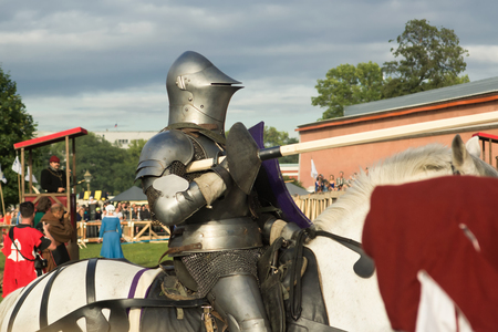 jousting: SAINT-PETERSBURG, RUSSIA - JULY 17, 2016: Battle on a Neva knightly tournament. Medieval jousting.