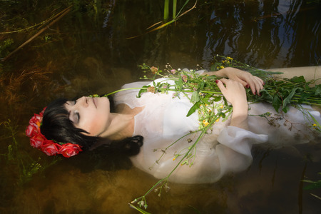 corpse flower: Young drown woman in a poetic representation. Stock Photo