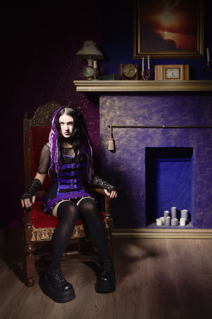 gothic girl: Cyber gothic girl in a dark room interior Stock Photo