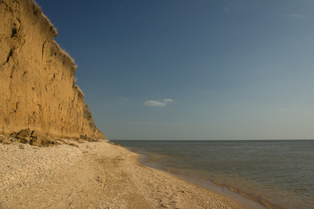 to spit: Empty wild Azov Sea beach under the coast precipice.  Dolzhanskaya spit, Krasnodar region, Russia.