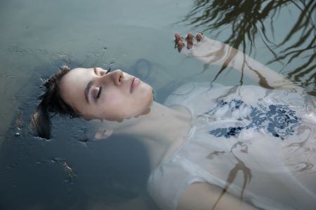 drown: Young drown woman in a poetic representation. Stock Photo
