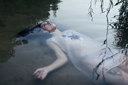 Young drown woman in a poetic representation. Stock Photo