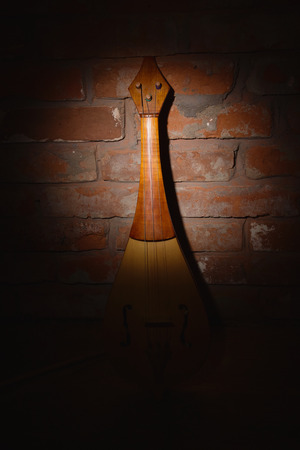 single songs: Renaissance violin (rebec) in a dark room