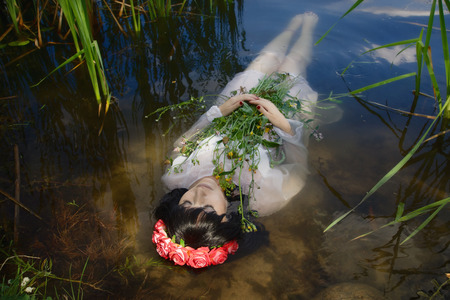 poetic: Young drown woman in a poetic representation. Stock Photo