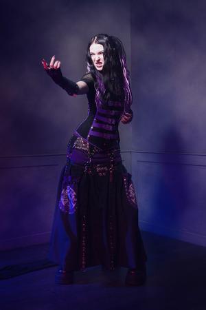 cyber girl: Cyber gothic girl in a dark room interior Stock Photo