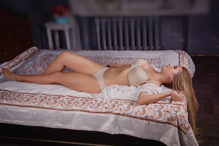 boudoir: Sexual woman in lingerie posing in a boudoir