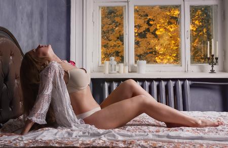 Sexual woman in lingerie posing in a boudoir
