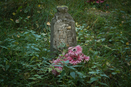 Old gravestone on ancient russian graveyard