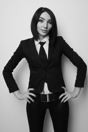 Confident pretty business woman dressed black suit