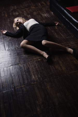Crime scene (imitation). Strangled business woman dressed black suit in a office