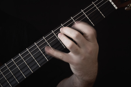 Guitarist Hand Playing. Motion blur. Extreme close-up Stock Photo