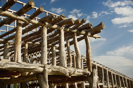rafters: Construction of the wooden building in a village Stock Photo
