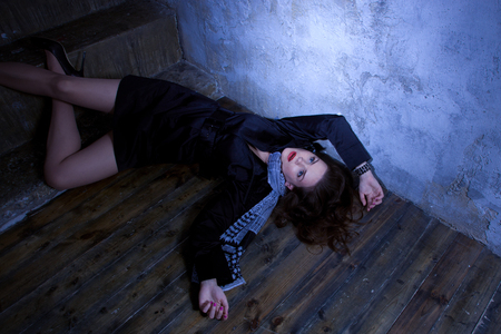 Noir film style. Crime scene with strangled retro styled fashion woman in a darkplace Stock Photo