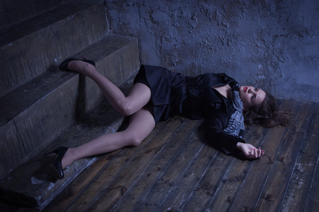 noire: Noir film style. Crime scene with strangled retro styled fashion woman in a darkplace Stock Photo