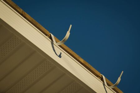 Construction of the roof of the house. Siding  Stock Photo