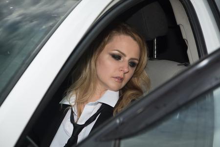 Business woman killed in the car. Crime scene imitation Stock Photo