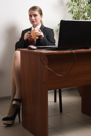 Attractive business woman with laptop in a office