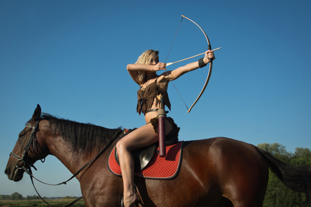 Wild amazon girl on horseback. Fantasy consept
