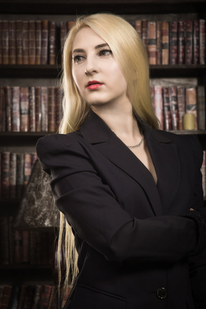 Confident business woman in the classical library room